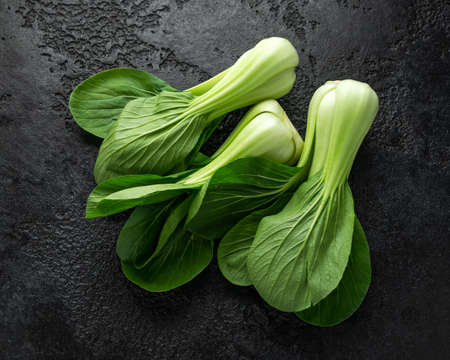 Pak Choi Chinese Cabbage on rustic black background 스톡 콘텐츠
