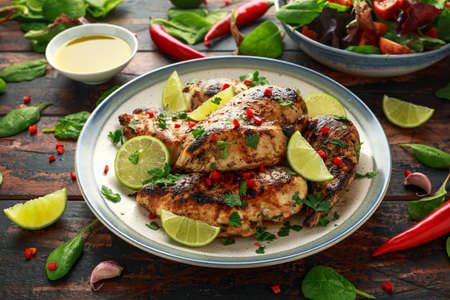 Homemade Grilled Chicken Breast in lime sauce with herbs 스톡 콘텐츠