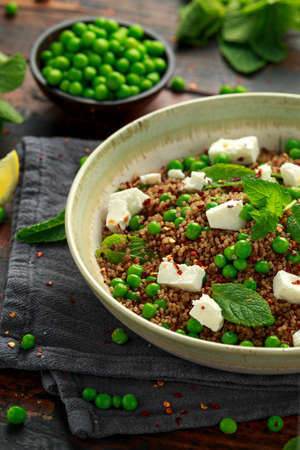 Quinoa salad with green pea, mint, feta cheese and chilli flake. healthy diet food.