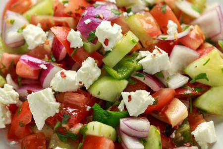 Turkish Shepards Salad with cucumber, tomato, red onion, pepper, parsley and Feta cheese 스톡 콘텐츠