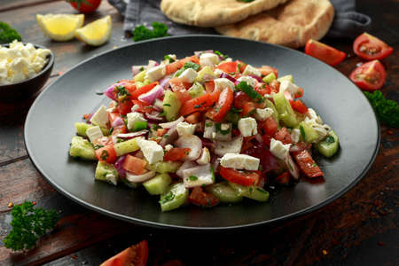 Turkish Shepards Salad with cucumber, tomato, red onion, pepper, parsley pita bread and Feta cheese 스톡 콘텐츠