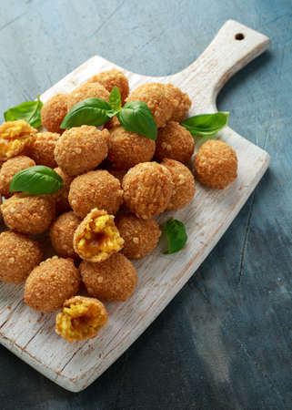 Fried Rice Balls with sweet hot sauce on wooden white board Stockfoto