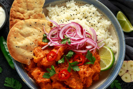 Meat free butternut squash curry with jasmine rice, pickled onions and naan bread