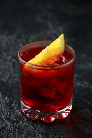 Classic Old Fashioned Negroni cocktail on rustic stone background