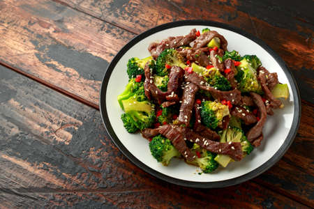 Homemade Beef and Broccoli on wooden table.