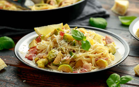 Homemade Brussels sprouts, bacon, pancetta pasta with parmesan cheese. On wooden table Stok Fotoğraf