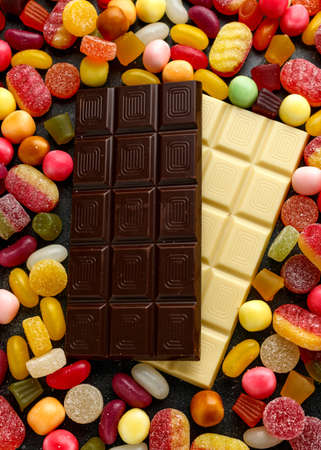 A lot of colorful candy with white and black chocolate