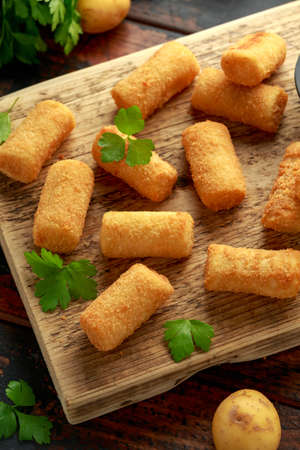 Homemade Potato Croquettes with dipping sauce on wooden board Archivio Fotografico