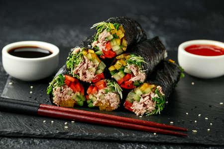 Vegetarian paleo diet nori wraps with tuna, cucumber, sweet pepper and microgreen radish sprouts Stock fotó