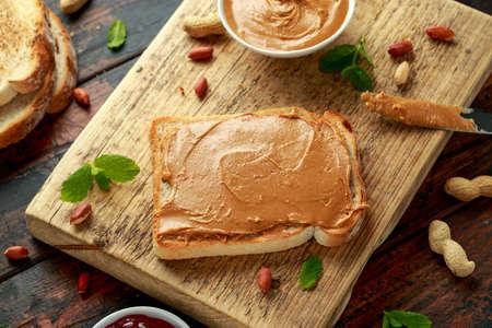 Peanut Butter Sandwich on wooden board. morning breakfast.