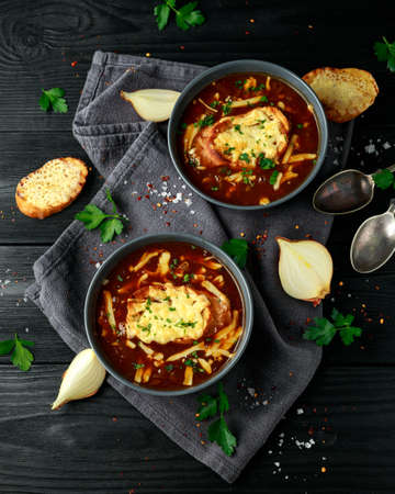 French onion soup with cheese toast on rustic background 스톡 콘텐츠