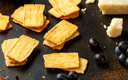 Cheese Crispies with garlic, parmesan, grape and chutney. party food snacks.