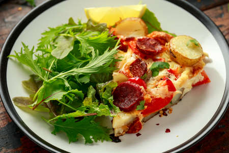 Chorizo Frittata with salad on black and white plate. healthy morning breakfast food Standard-Bild