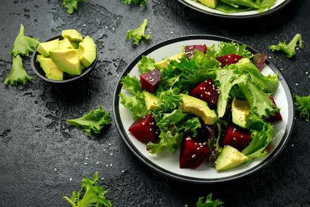 Vegetarian avocado and beet salad in plate. Healthy vegan food