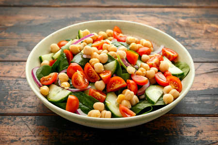 Chickpeas salad with tomato, cucumbers, red onion and greens. Dietary food. Vegan salad. 스톡 콘텐츠
