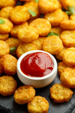 Mini hash browns, tater tots crispy golden potato bites served with jalapeno peppers dipped in ketchup
