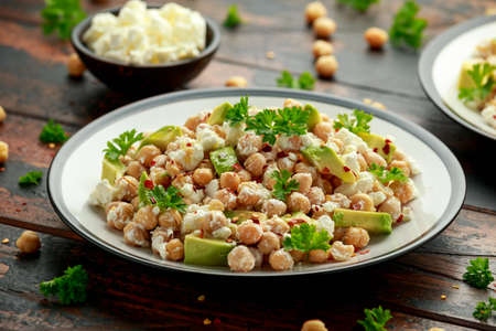 Chickpeas salad with feta cheese, avocado and herbs. healthy food