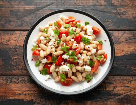 White Bean Salad with Cherry Tomatoes, Feta cheese and parsley. Healthy vegetarian, vegan food