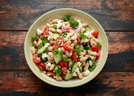 Bean Salad with Cherry Tomatoes, Cucumber, Red onion, Feta cheese and parsley. Healthy vegetarian, vegan diet food