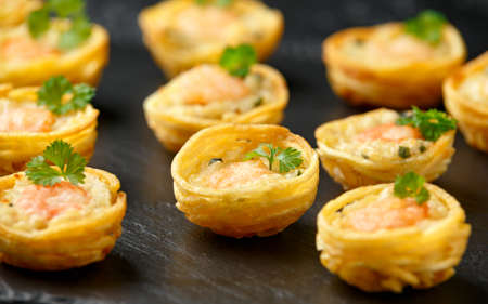 Mini party Fish Pie Food with prawn on rustic stone background 写真素材