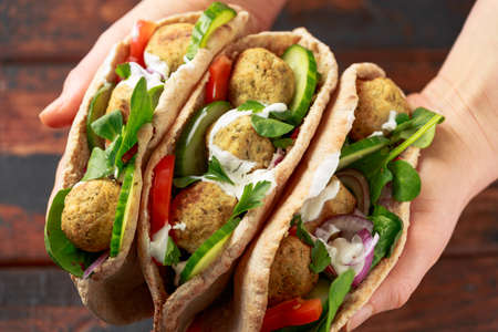 Vegetarian Chickpea falafel pita bread with pickled chilies and fresh salad. healthy vegan food. 版權商用圖片