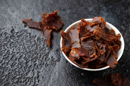 Dried Beef Jerky snack in white bowl