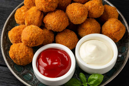 Meat free vegetarian mini picnic scotch eggs with micoprotein and herbs served with ketchup and mayonnaise