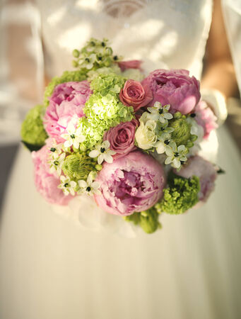 Bride with beautiful flower bouquet in hands.close up