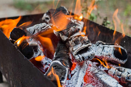 burning wood in a brazier, mangal or bbq