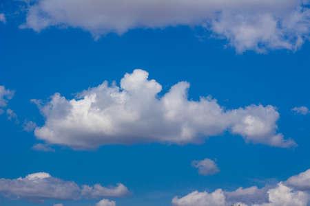 White cumulus clouds in a blue sky