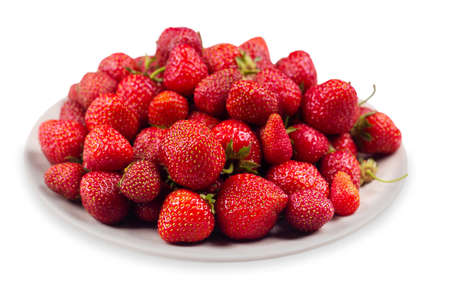 Strawberries on a plate isolated on a white background
