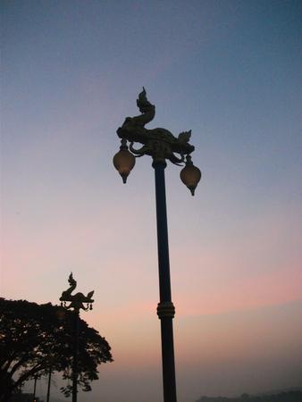 Electricity post of Phaya Nak at Chiang Khan river view sunset photo