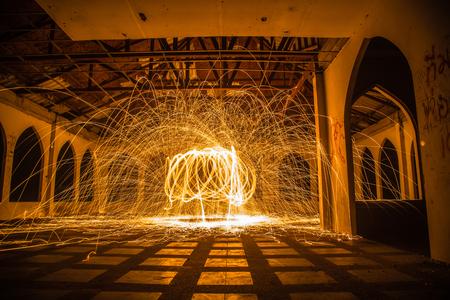 steel wool: Burning steel wool fireworks in abandoned building.
