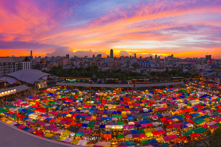 Bird eyes view of Multi-colored tents Sales of second-hand market at twilight - Panorama picture