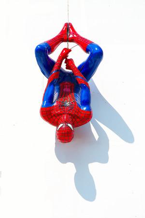 Ayuttaya, Thailand - December 30, 2014 : Spider-Man model upside down on billboards at Thung Bua Chom floating market