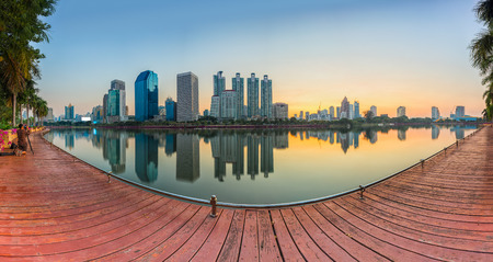 benjakitti: Landscape panorama skyscraper business district at dawn sky, beautiful water reflection. Stock Photo