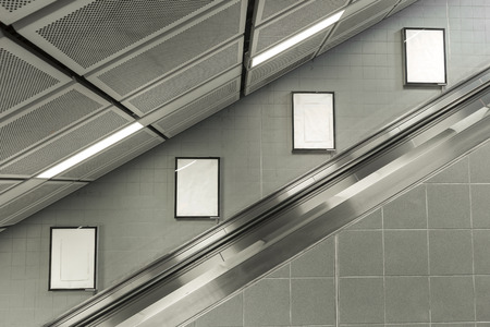 Four big vertical / portrait orientation blank billboard with escalator background.