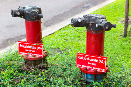 Red Fire pumps, Fire Department Connector, Fire hydrant, Hose Connection, Fire Fighting Equipment for fire fighter on the street
