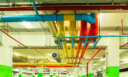 Pipe systems, pipeline extinguishing water on industrial building ceiling.