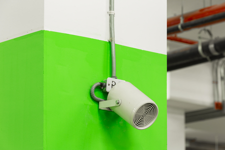 amp: Ceiling Projector Speaker in parking lot area. Stock Photo