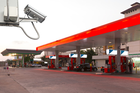 Closed Circuit Television camera monitoring gas station. Imagens