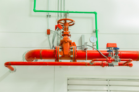 Industrial fire protection system with pressure gauge for measuring pressure, pipeline extinguishing water on the wall.