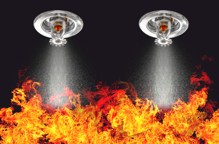 Image of Fire Sprinklers Spraying with fire background. Fire sprinklers are part of an overall safety protocol for fire and life safety. Archivio Fotografico