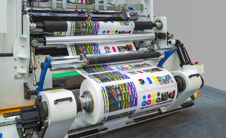Large offset printing press or magazine running a long roll off paper in production line of industrial printer machine. Zdjęcie Seryjne - 82568603