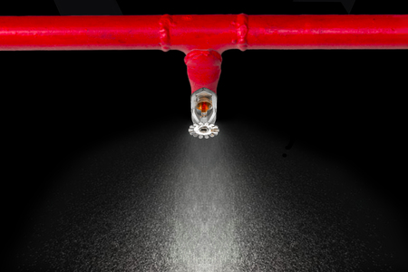 Image of pendent fire sprinkler on white background . Fire sprinklers are part of an overall safety protocol for fire and life safety.