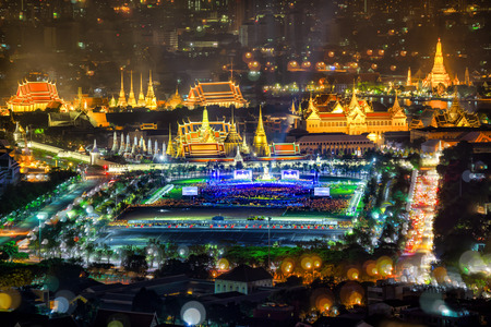 Fireworks on Father's day while King Bhumibol's body was living in as passed away Grand Palace Emerald Buddha city view skyline at night, Bangkok, Thailand.