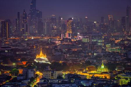 Golden mountain in Wat Saket Ratcha Wora Maha Wihan and Lohaprasat in Wat Ratchanatdaram Worawihan which is landmar in Bangkok, Thailand with bangkok cityscape background.