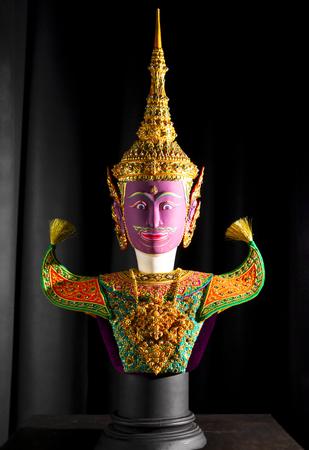 Thai Khon Mask (Vishnu Phra Narai) isolated on black background.