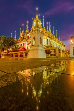 Beautiful sky and Wat Ratchanatdaram Temple in Bangkok, Thailand. Thai architecture: Wat Ratchanadda, Loha Prasat and Traditional Thai pavilion is among the best of Thailands landmarks. 版權商用圖片