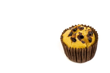 Fresh homemade delicious vanila and chocolate muffins in paper cupcake holder isolated on white background.  With copy space for texts. 版權商用圖片